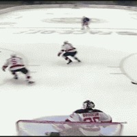 hockey puck hits camera