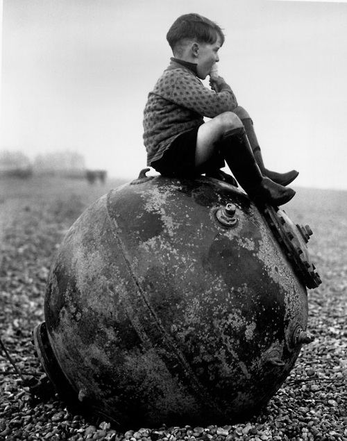 german kid sitting on a mine