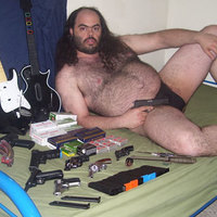 weird ass guy with guns and guitar