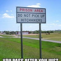 sign by prison